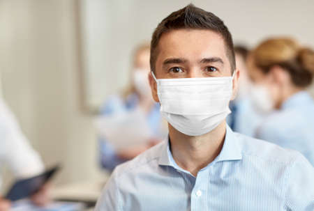 businessman wearing face protective mask at office