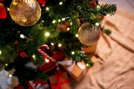 decorated artificial christmas tree at home Stock Photo