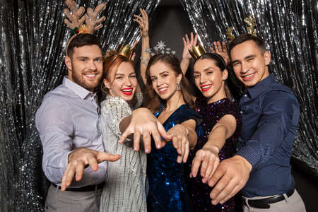 happy friends posing at christmas party Stock Photo