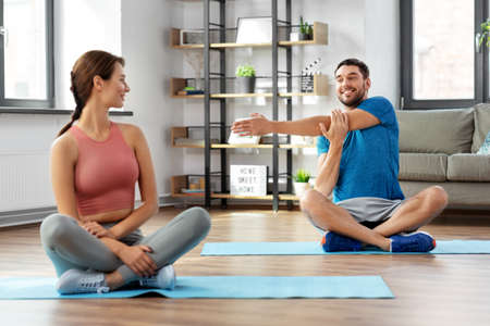 happy couple exercising at home Stock Photo
