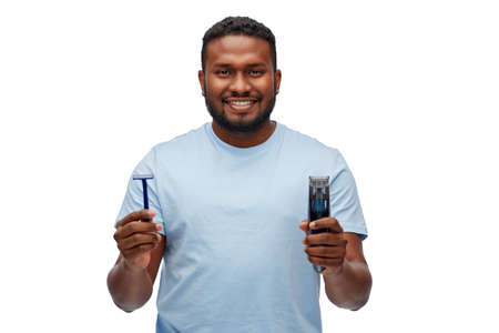 smiling african man with razor blade and trimmer