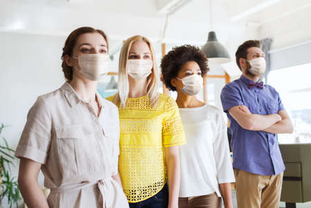 business team in masks in office