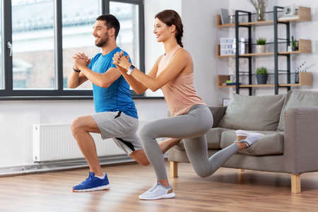 couple exercising and doing lunge at home