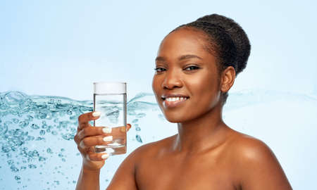young african american woman with glass of water