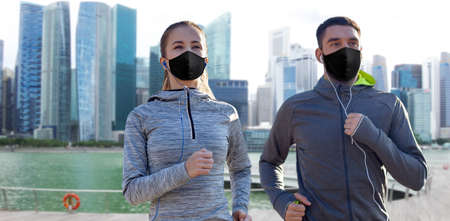 couple in masks jogging in singapore