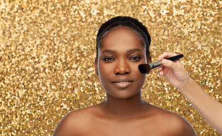 african woman and hand with make up brush