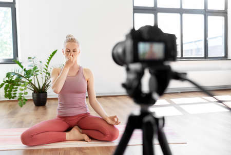 woman or blogger recording gym yoga class video