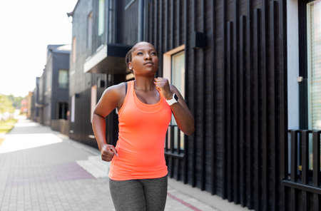 young african american woman running in city Standard-Bild