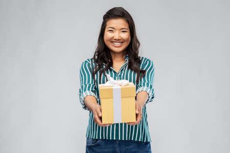 happy asian woman with birthday present Standard-Bild