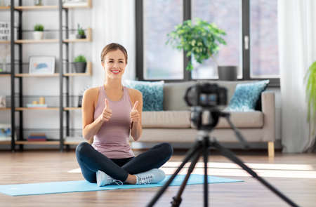 woman or blogger recording training class at home