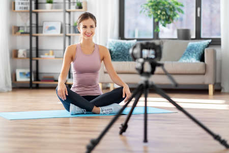 woman or sports blogger streaming online at home