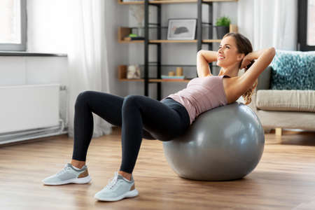 happy woman exercising on fitness ball at home Reklamní fotografie