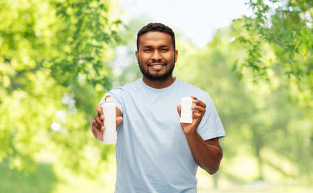 african american man with antiperspirant deodorant Stock Photo