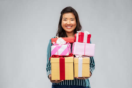 happy asian woman with birthday presents