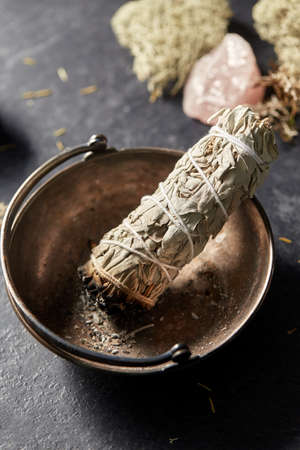 white sage in cup and staff for magic ritual