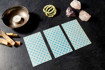 tarot cards and magic staff for divination ritual Stock Photo