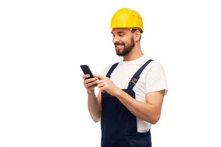 happy male worker or builder with smartphone Stockfoto