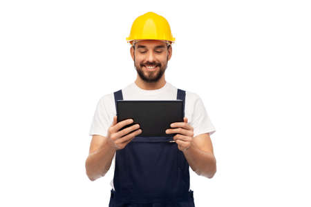 happy male worker or builder with tablet computer