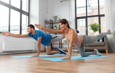 happy couple exercising at home Reklamní fotografie