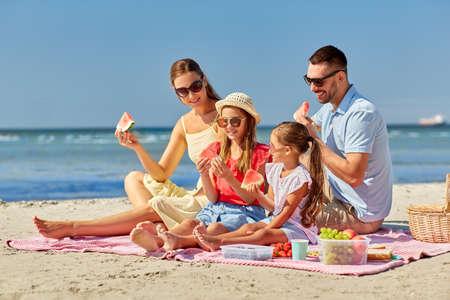 happy family having picnic on summer beach Stockfoto