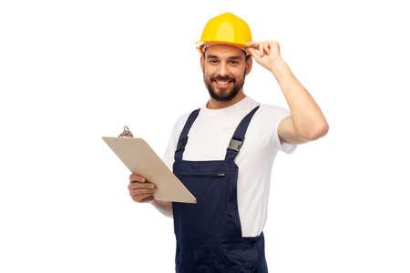 male worker or builder in helmet with clipboard Zdjęcie Seryjne