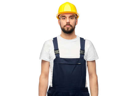 male worker or builder in helmet and overall