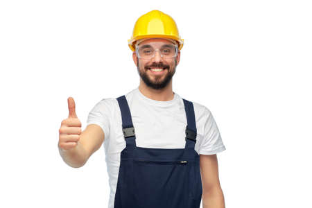 happy male worker or builder showing thumbs up Zdjęcie Seryjne