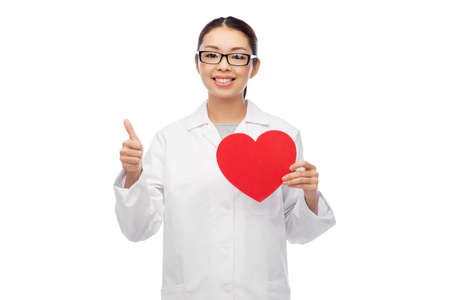 happy smiling asian female doctor with red heart