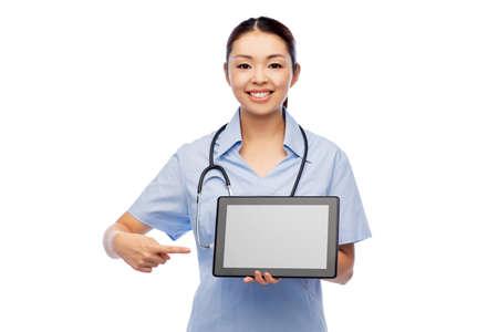 asian female doctor with tablet pc and stethoscope Zdjęcie Seryjne