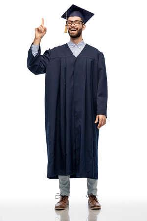 happy graduate student pointing his finger up Zdjęcie Seryjne