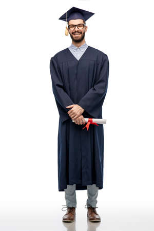 male graduate student in mortar board with diploma