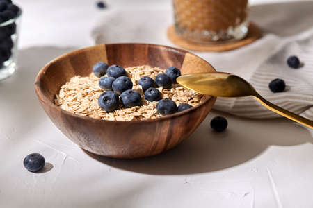 close up of oatmeal in bowl with blueberries