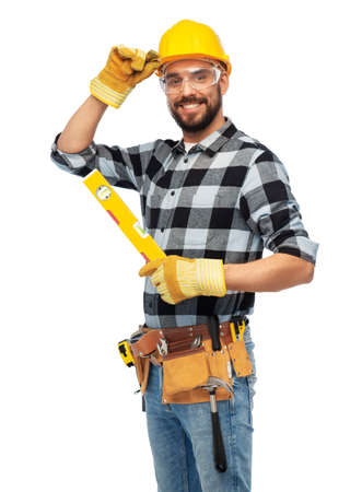 happy male worker or builder in helmet with level