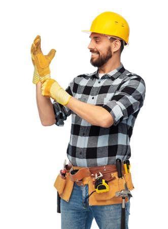 happy male worker or builder in helmet and gloves