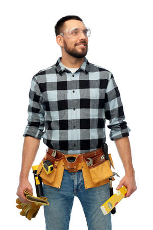 happy male worker or builder with tools and level