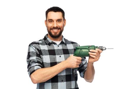 happy man, worker or builder with drill Zdjęcie Seryjne
