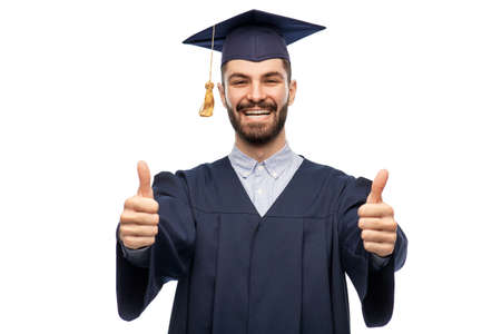 happy male graduate student showing thumbs up Zdjęcie Seryjne