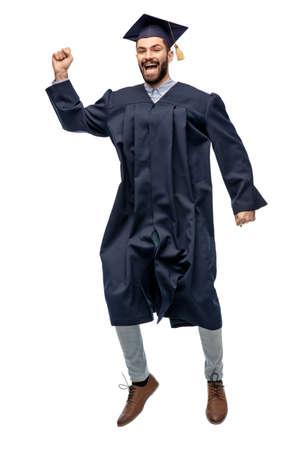 happy male indian graduate student jumping Zdjęcie Seryjne