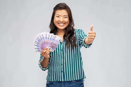 asian woman with euro money showing thumbs up Stock fotó