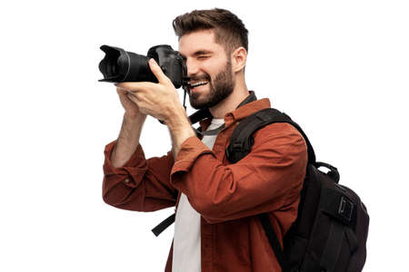happy man or photographer with camera and backpack