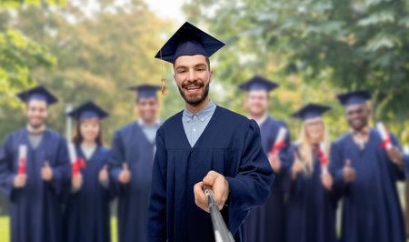 male graduate student taking selfie with monopod