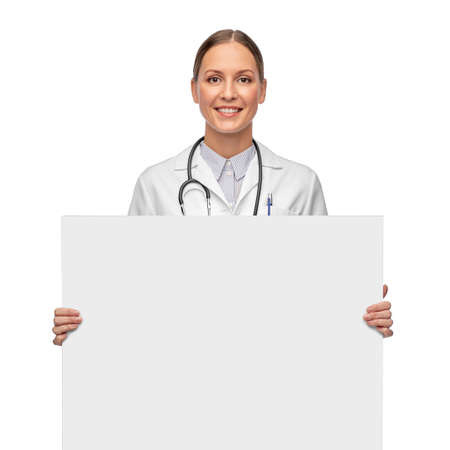 happy smiling female doctor holding white board