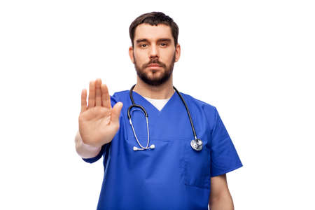 doctor or male nurse showing stop gesture Standard-Bild