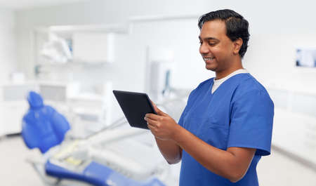 happy doctor or male dentist using tablet computer 스톡 콘텐츠