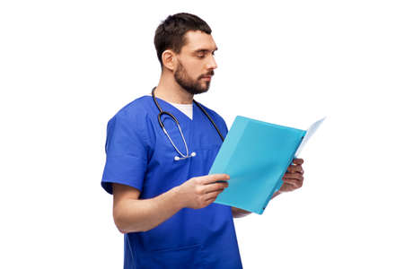 male doctor reading medical report in folder 스톡 콘텐츠