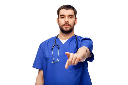 doctor or male nurse pointing to camera Standard-Bild