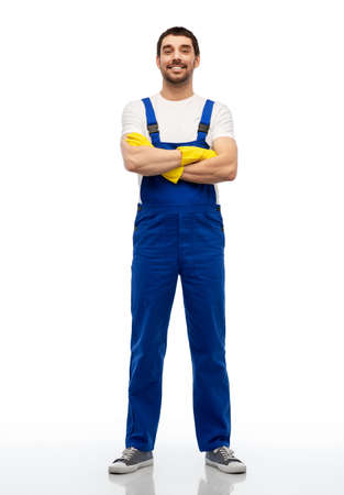 happy male worker or cleaner in overal and gloves