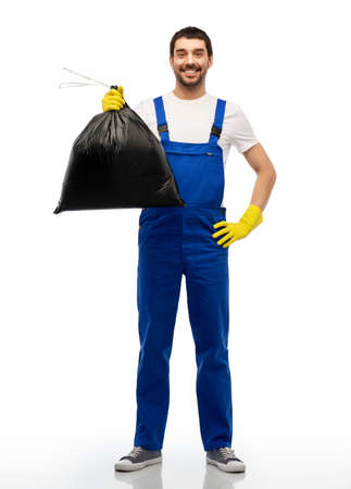 happy male worker or cleaner with garbage bag