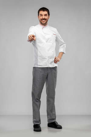 happy smiling male chef in jacket