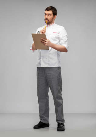 thinking male chef with clipboard and pencil